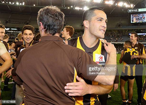 Coach Damian Carroll and Shane Savage of the Hawks celebrate winning the VFL Grand Final match between the Box Hill Hawks and the Geelong Cats at...