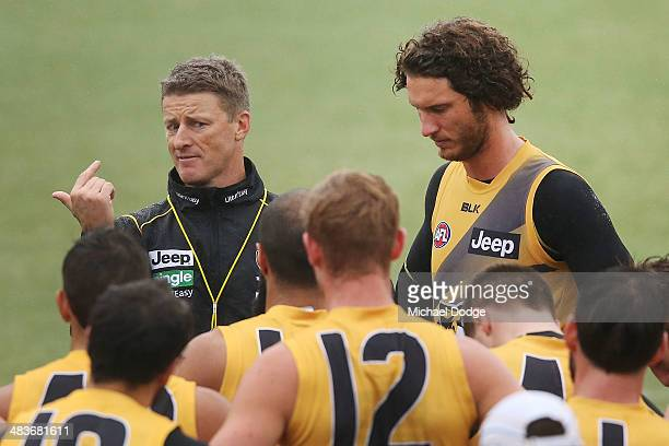 Coach Damien Hardwick gestures to Tyrone Vickery during a Richmond Tigers AFL training session at ME Bank Centre on April 10 2014 in Melbourne...