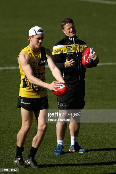 Coach Damien Hardwick looks on as Jacob Townsend prepares to kick during a Richmond Tigers AFL training session at Punt Road Oval on August 25 2017...