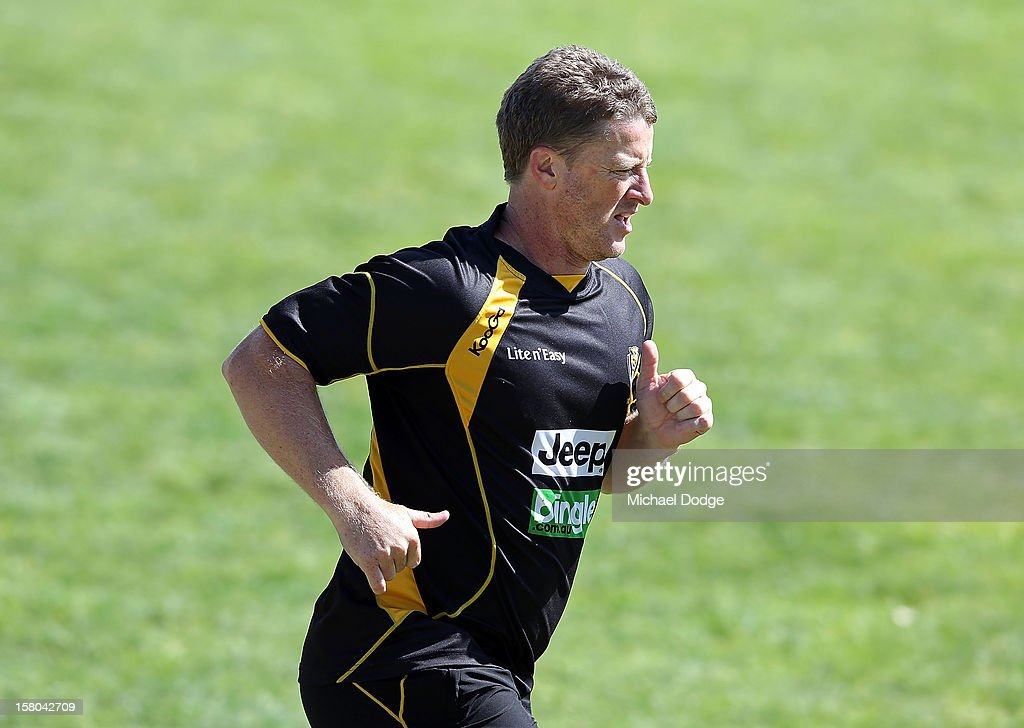 Coach Damien Hardwick runs some laps with the players during a Richmond Tigers AFL training session at Trevor Barker Beach Oval on December 10, 2012 in Melbourne, Australia.