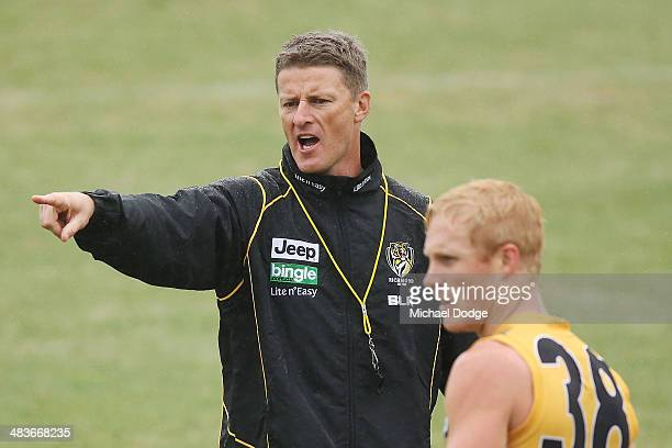 Coach Damien Hardwick shouts insructions to his players during a Richmond Tigers AFL training session at ME Bank Centre on April 10 2014 in Melbourne...