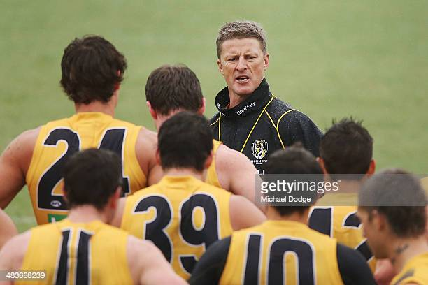Coach Damien Hardwick speaks to his players during a Richmond Tigers AFL training session at ME Bank Centre on April 10 2014 in Melbourne Australia