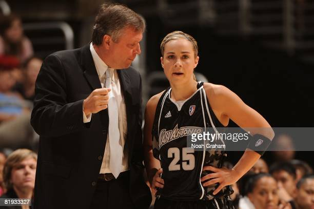 Coach Dan Hughes and Becky Hammon of the San Antonio Silver Stars discuss a play against the Los Angeles Sparks during the game at Staples Center...