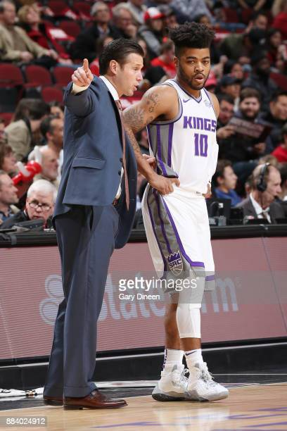 Coach David Joerger of the Sacramento Kings speaks with Frank Mason III during the game against the Chicago Bulls on December 1 2017 at the United...