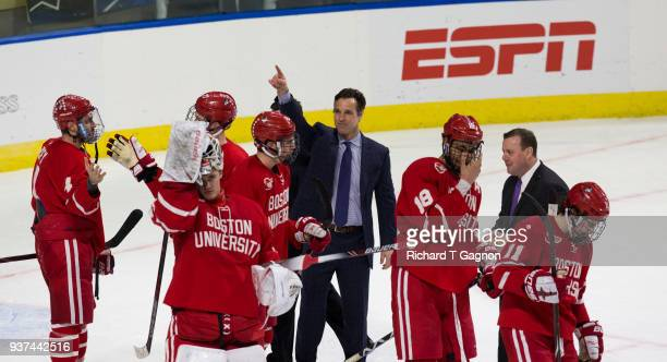 Coach David Quinn of the Boston University Terriers celebrates a 31 victory against the Cornell Big Red during the NCAA Division I Men's Ice Hockey...