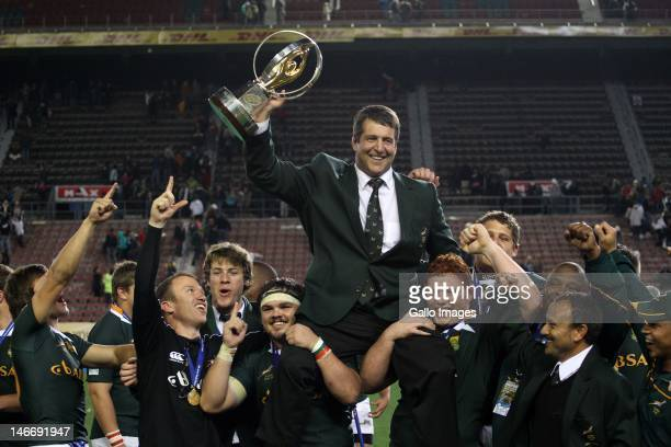Coach Dawie Theron of South Africa players celebrate during the trophy presentation of the IRB Junior World Championships final match between South...