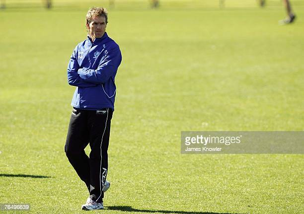 Coach Dean Laidley watches during a Kangaroos AFL training session held at Arden Street September 4 2007 in Melbourne Australia