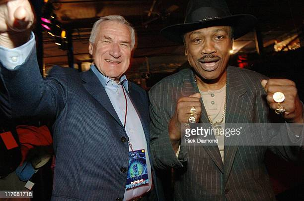 Coach Dean Smith and 'Smoking' Joe Frazier during Jefferson Pilot Presents The Southern Sports Awards at TABERNACLE in Atlanta Georgia United States