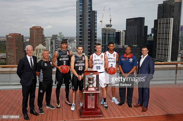 Coach Dean Vickerman Josh Boone and Chris Goulding of Melbourne United along with Mitch Creek Josh Childress and coach Joey Wright of the Adelaide...