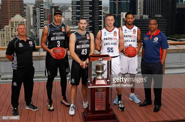 Coach Dean Vickerman, Josh Boone and Chris Goulding of Melbourne United along with Mitch Creek, Josh Childress and coach Joey Wright of the Adelaide...