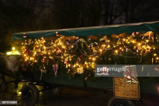 Coach decorated for christmas Last Day of the Christmas Market at quotChinesischer Turmquot in Munich on December 23 2017