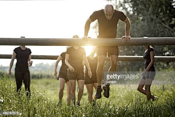 coach demonstrating to group of women how to cross obstacle - barracks stock pictures, royalty-free photos & images