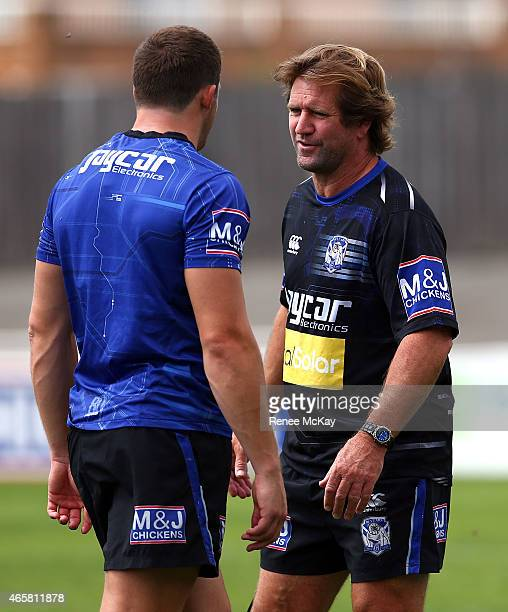 Coach Des Hasler talks with Josh Morris during a Canterbury Bulldogs NRL training session at Belmore Sports Ground on March 11 2015 in Sydney...
