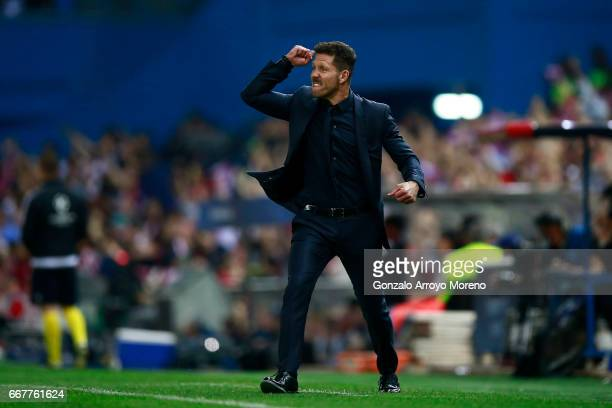 Coach Diego Pablo Simeone of Atletico de Madrid celebrates his team's opening goal during the UEFA Champions League Quarter Final first leg match...