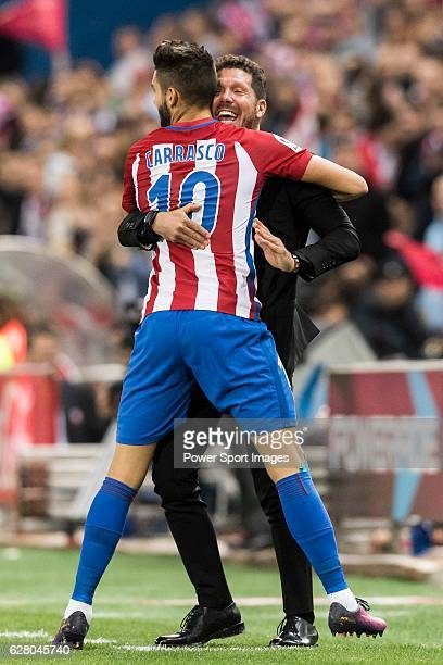 Coach Diego Simeone of Atletico de Madrid celebrates with Yannick Ferreira Carrasco of Atletico de Madrid during their La Liga match between Atletico...