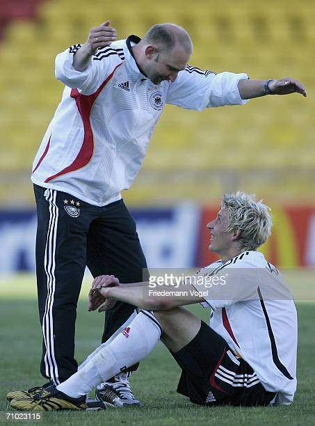 Coach Dieter Eilts and Stefan Kiesling of Germany celebrate after winning the UEFA U21's Championship Group A match between Serbia Montenegro and...