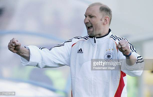 Coach Dieter Eilts of Germany celebrates after winning the UEFA U21's Championship Group A match between Serbia Montenegro and Germany at the Stadium...