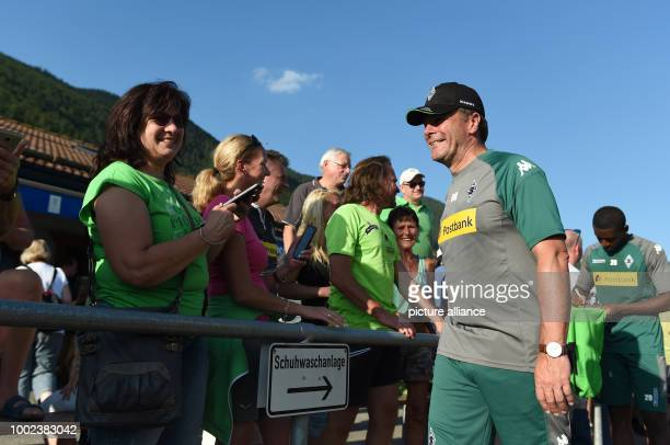 Coach Dieter Hecking signs autographs after training at the Borussia Moenchengladbach training camp in Rottach-Egern, Germany, 17 July 2017. Photo:...