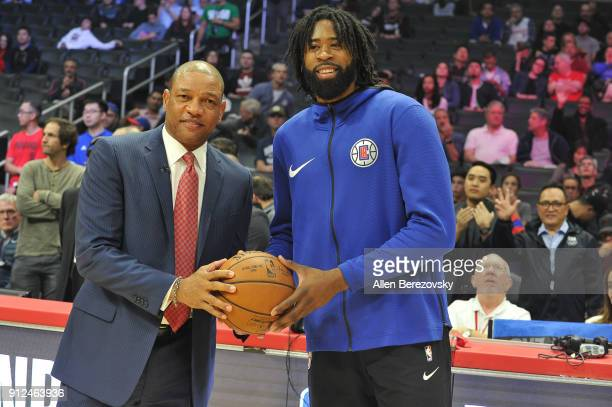 Coach Doc Rivers and DeAndre Jordan pose for a picture prior to a basketball game between the Los Angeles Clippers and the Portland Trail Blazers at...