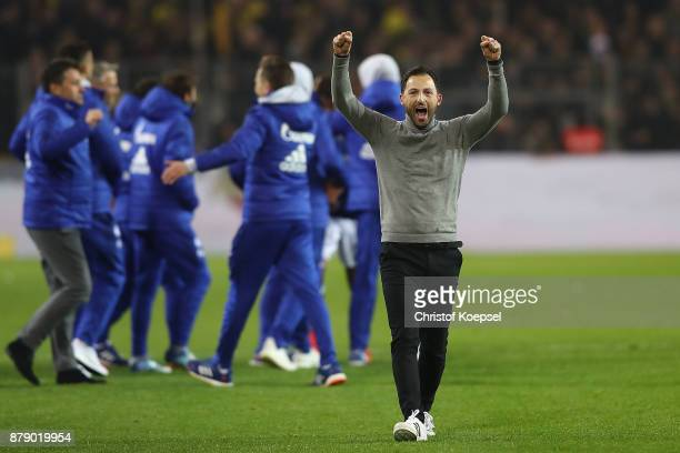 Coach Domenico Tedesco of Schalke celebrates after the Bundesliga match between Borussia Dortmund and FC Schalke 04 at Signal Iduna Park on November...