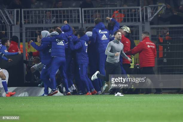 Coach Domenico Tedesco of Schalke runs back to the bench after celebrating a goal to make it 4:4 with his team during the Bundesliga match between...