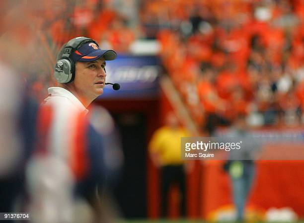 Coach Doug Marrone of the Syracuse Orange talks to his team during the game against the South Florida Bulls at the Carrier Dome on October 3, 2009 in...