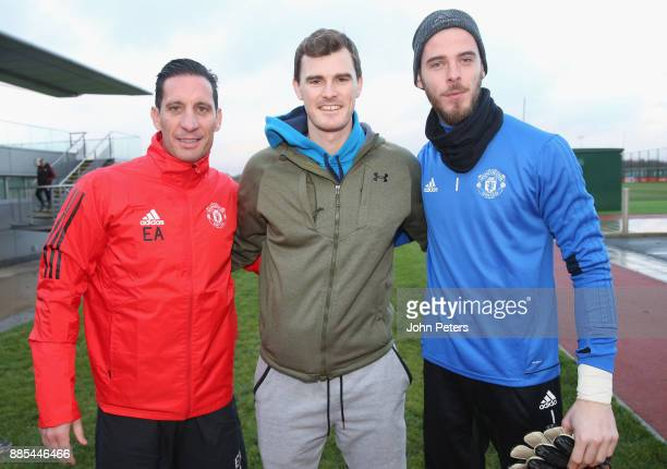 Coach Emilio Alvarez and David de Gea of Manchester United pose with tennis player Jamie Murray ahead of a first team training session at Aon...