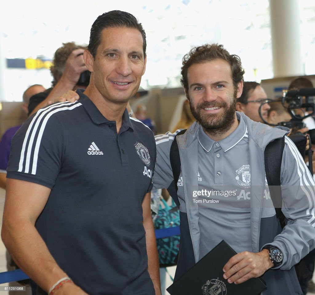 Coach Emilio Alvarez and Juan Mata of Manchester United pose at Manchester Airport ahead of the club's pre-season tour of the USA at Manchester Airport on July 9, 2017 in Manchester, England.