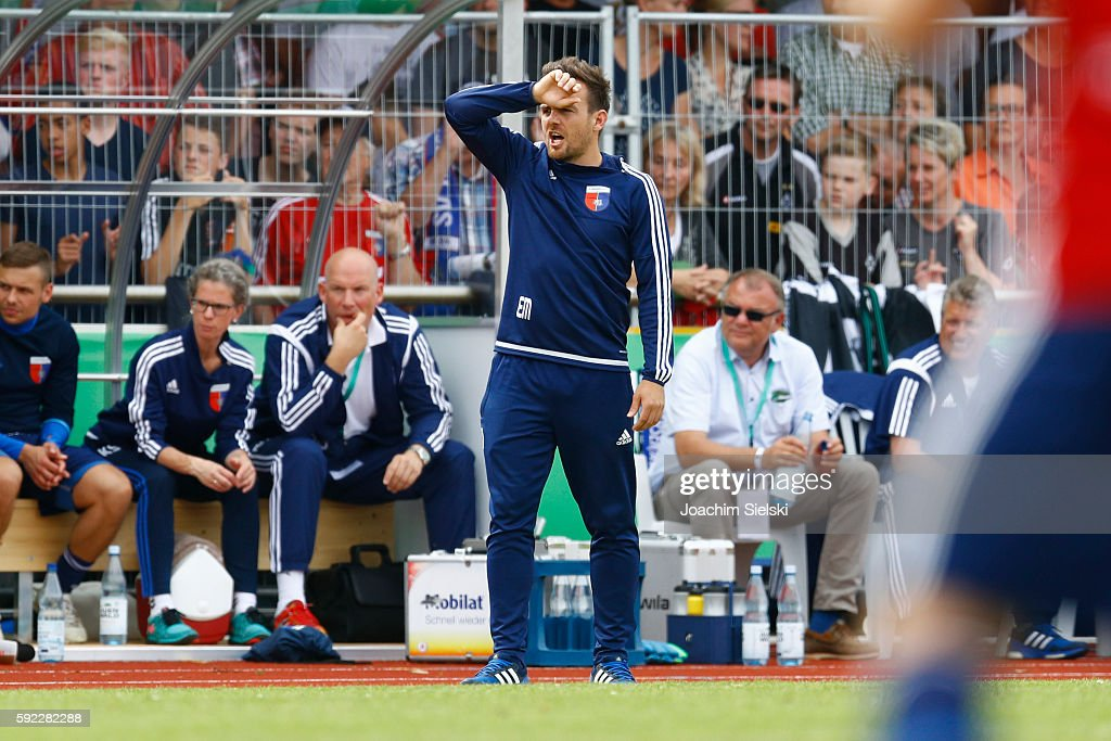 Coach Enrico Maassen of Drochtersen looks on during the DFB Cup match between SV Drochtersen/Assel and Borussia Moenchengladbach at Kehdinger Stadion on August 20, 2016 in Drochtersen, Germany.