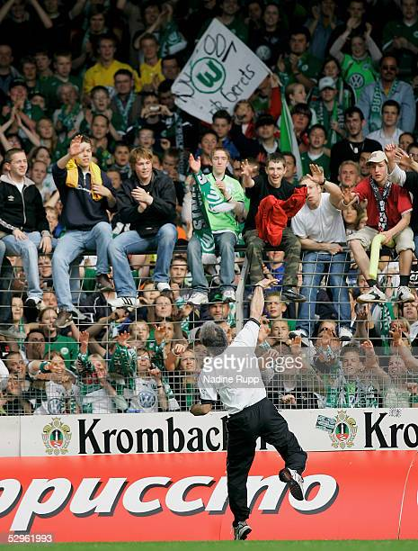 Coach Erik Gerets of Wolfsburg throws his jacket to the fans after winning the Bundesliga match between Arminia Bielefeld and VfL Wolfsburg at the...