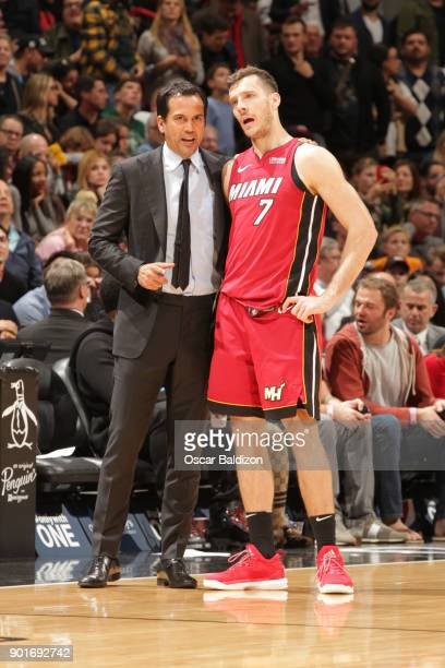 Coach Erik Spoelstra of the Miami Heat guides Goran Dragic during the game against the New York Knicks on January 5 2017 at American Airlines Arena...