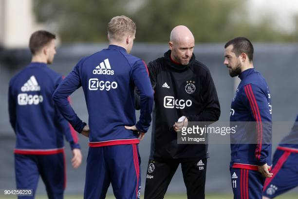 Coach Erik ten Hag of Ajax Amin Younes of Ajax during a training session of Ajax Amsterdam at the Cascada Resort on January 12 2018 in Lagos Portugal