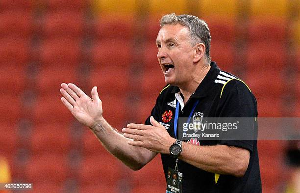 Coach Ernie Merrick of the Phoenix calls out instructions to his players during the round 16 ALeague match between the Brisbane Roar and the...