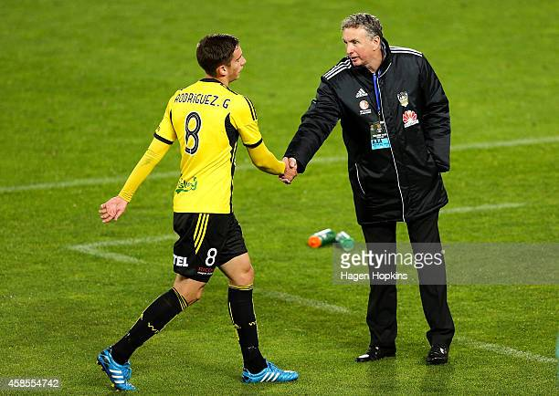 Coach Ernie Merrick of the Phoenix shakes the hand of Alex Rodriguez as he leaves the field during the round five ALeague match between the...