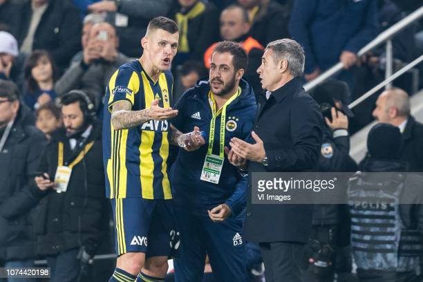 coach Ersun Yanal of Fenerbahce SK give instructions to Martin Skrtel of Fenerbahce SK during the Turkish Spor Toto Super Lig match Fenerbahce AS and...