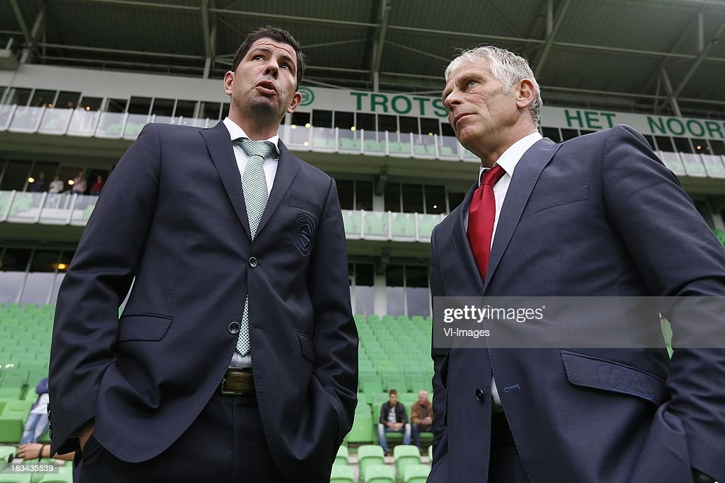 Coach Erwin van de Looi of FC Groningen, Coach Martin Haar of AZ during the Dutch Eredivisie match between FC Groningen and AZ Alkmaar at De Euroborg on Oktober 6, 2013 in Groningen, The Netherlands