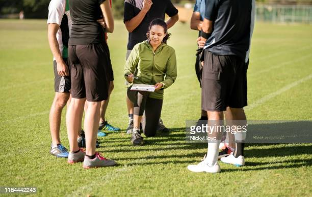 coach explaining game plan - pep talk stock pictures, royalty-free photos & images