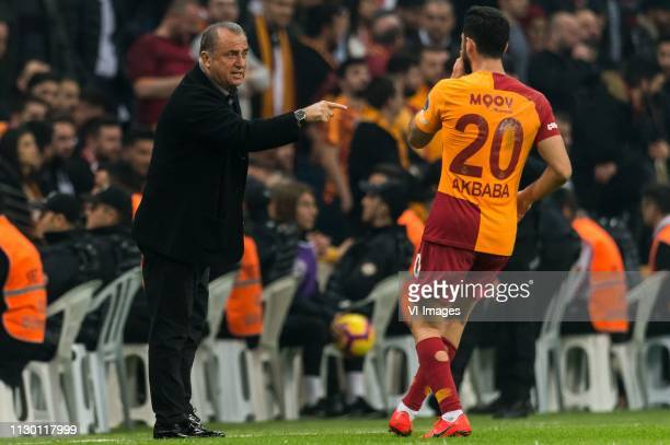 coach Fatih Terim of Galatasaray SK give instructions to Emre Akbaba of Galatasaray SK during the Turkish Spor Toto Super Lig football match between...