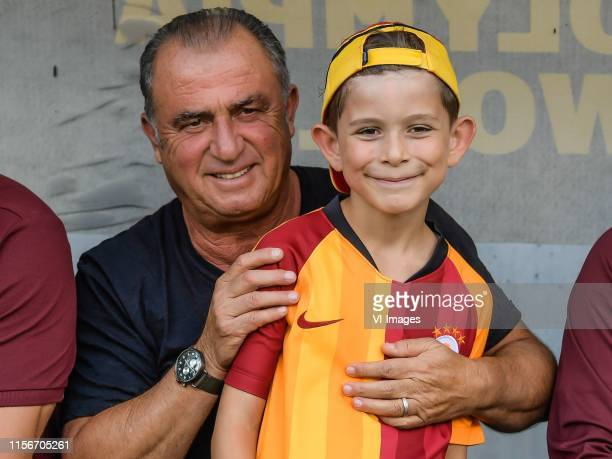 Coach Fatih Terim of Galatasaray SK with a young supporter during the Pre-season Friendly match between Red Bull Leipzig v Galatasaray SK at Stadion...