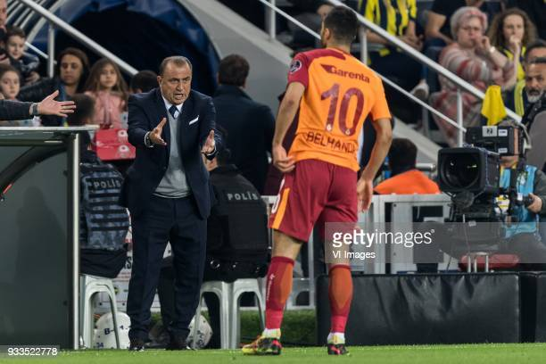 coach Fatih Terim of Galatasaray SK Younes Belhanda of Galatasaray SK during the Turkish Spor Toto Super Lig match Fenerbahce AS and Galatasaray AS...