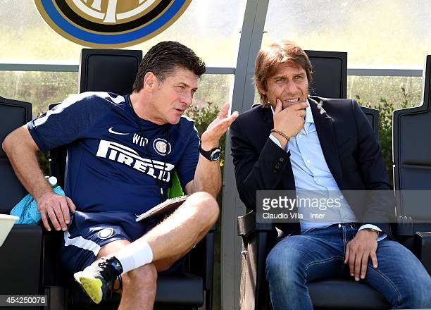 Coach FC Internazionale Walter Mazzarri and Coach Italy Antonio Conte during FC Internazionale Training Session at Appiano Gentile on August 27 2014...