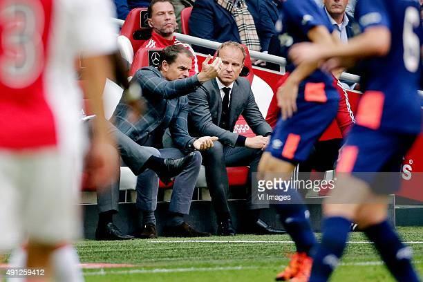 coach Frank de Boer of Ajax assistant trainer Dennis Bergkamp of Ajax during the Dutch Eredivisie match between Ajax Amsterdam and PSV Eindhoven at...