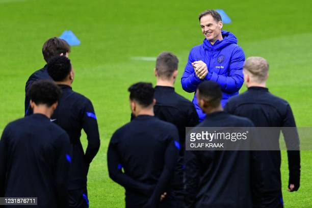 Coach Frank de Boer of the Dutch national team addresses his players during a training session in Zeist, on March 22 in preparation for the World Cup...