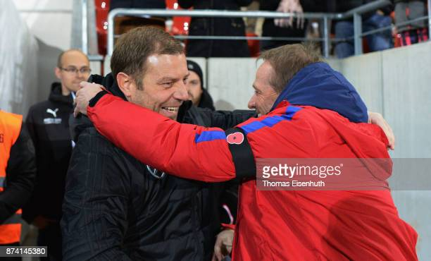 Coach Frank Kramer of Germany and coach Keith Downing of England react prior the Under 20 International Friendly match between U20 of Germany and U20...