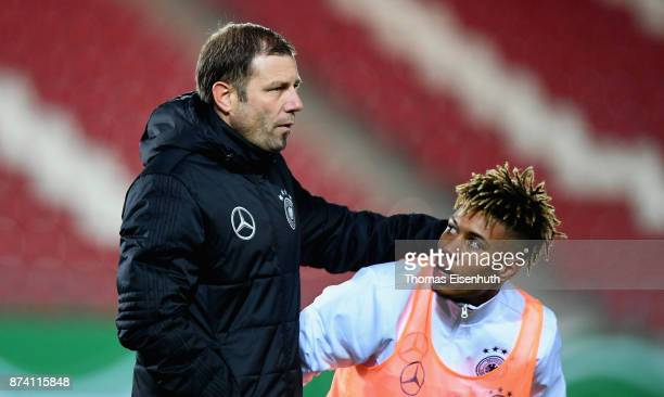 Coach Frank Kramer of Germany speaks to Sidney Friede prior the Under 20 International Friendly match between U20 of Germany and U20 of England at...