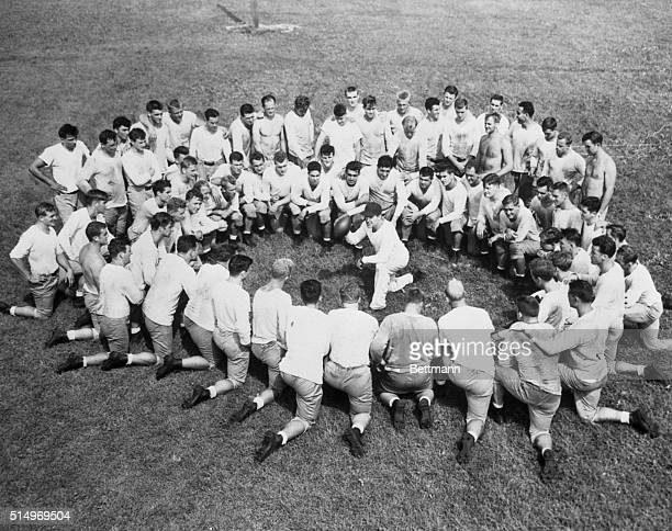 Coach Frank Leahy of Notre Dame is the center of this circle formed by about 70 candidates for places on the 'Irish' football team for the 1947...