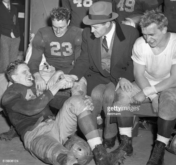 Coach Frank Leahy shakes hands here with Bernie Crimmins the star guard of the first Notre Dame team since Rockne's 1930 team to finish unbeaten...