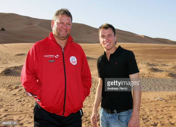 Coach Frank Pagelsdorf and his new tranfered player Tobis Rathgeb from VFB Stuttgart look on during a desert tour outside of Dubai City during the...