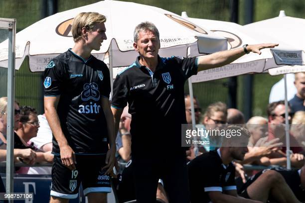 coach Frank Wormuth of Heracles Almelo give instructions to Vincent Vermeij of Heracles Almelo during the Friendly match between Heracles Almelo and...