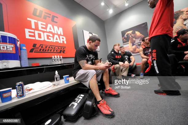 Coach Frankie Edgar sits in the locker room after his fighter Dhiego Lima defeated team Penn fighter Tim Williams in their preliminary fight during...